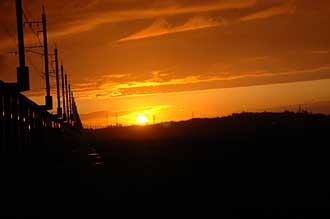 ほくほく線と夕陽